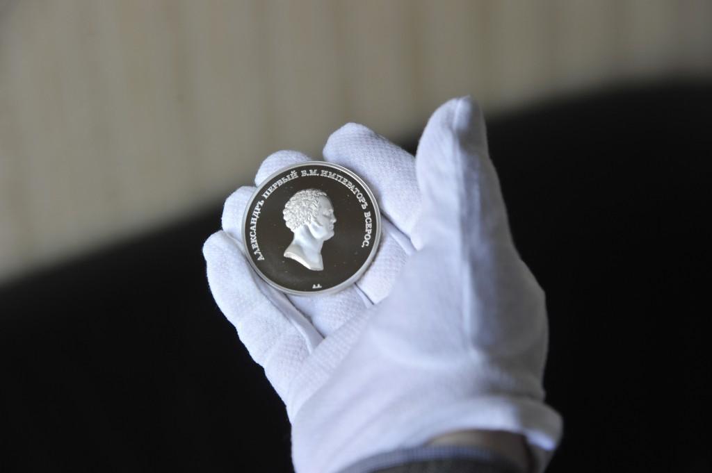 Медали, выполненные по эскизам А.Н. Оленина